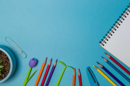 School supplies. Top view on a blue background with copy space. Back to school concept.