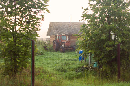 Rural landscape on a early foggy morning in the village