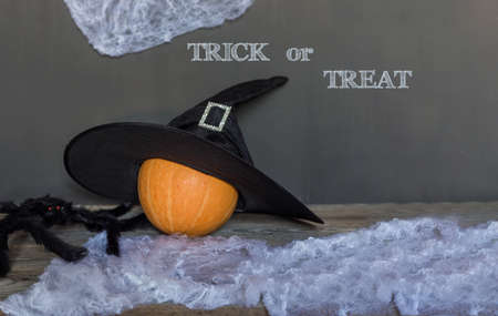 Trick or treat greeting text over dark wooden and Blackboard background Stock fotó - 155444800