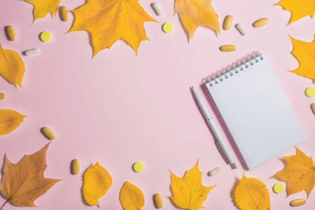 Autumn fallen leaves, office and medicines background