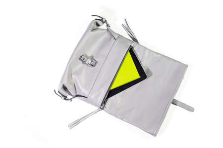 Modern woman accessories on white background. Things from open bag.