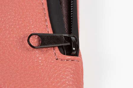 Zipper and pocket on bag on white background.