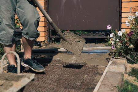 Cementing garden paths on top of metal mesh, construction work in the garden