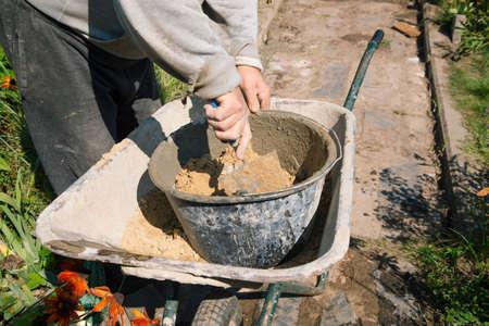 Mixing cement to fill the garden path, garden construction work