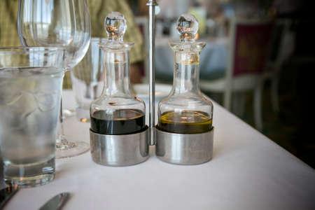 restaurant setting: Gourmet restaurant setting: oil and vinegar