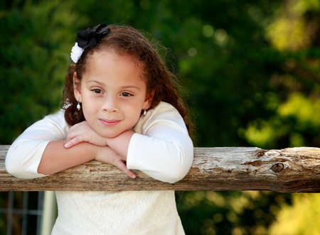 mixed race person: Outdoor portrait of a beautiful African American little girl