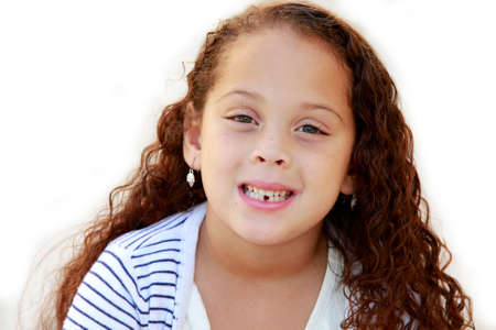 Portrait of a beautiful African American little girl isolated on white with missing tooth