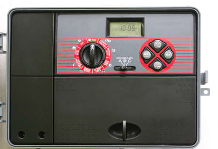 sprinkler: Modern Automatic Sprinkler System Control Timer Stock Photo