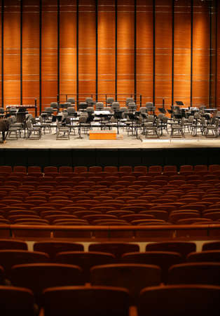 Empty concert hall with stage set for full symphony orchestra