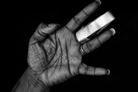 fractured: Nicely manicured hand of African-American woman with cast for arthritis or fractured finger
