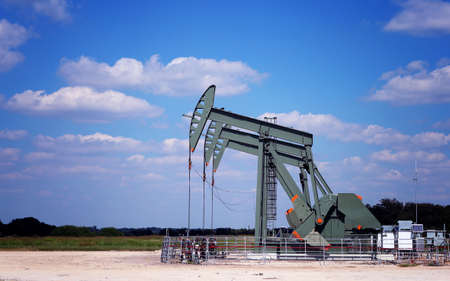 nodding: Oil Pumps on the field. Oil industry equipment.