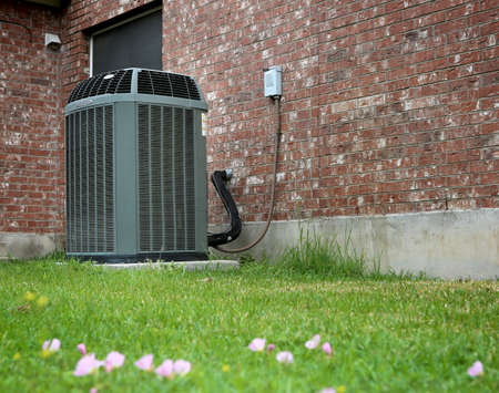High efficiency modern AC-heater unit on brick wall background