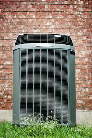Save Download Preview High efficiency modern AC-heater unit on brick wall background