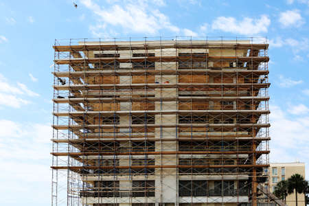 old building facade: Old building facade under reconstruction with scaffolding