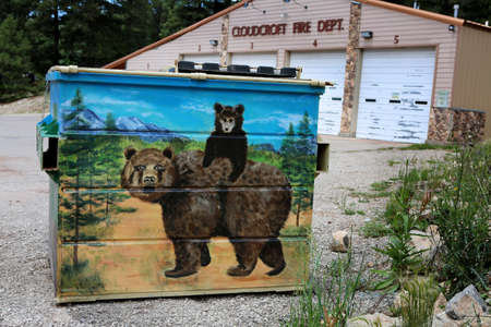 Painted dumpster, Cloudcroft, New Mexico, July 26, 2017 Garbage container painted with wild life motive, domestic artists' action.