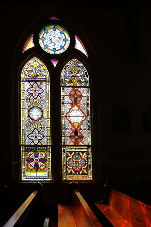 November 14, 2017. Schulenburg, Texas. Painted churches of Texas. Light shining though stained-glass high gothic window.