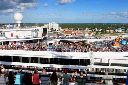 October 26, 2017. Cancun, Mexico.  Waiving happy crowd of a large cruise ship. Hot sunny day. Vacation is fun!