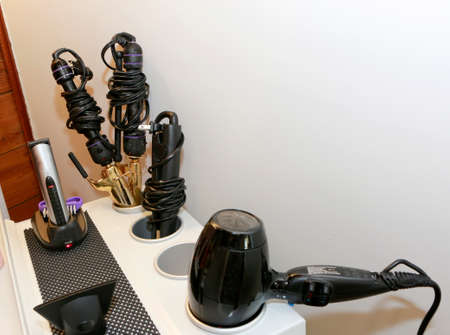 Beauty salon: beautician stand with hair styling accessories