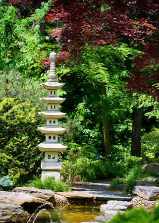 a chinese or japanese garden with small pagoda sculpture.