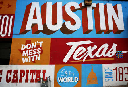 AUSTIN, TEXAS - MAR 11, 2018: Wall at famous 6th street painted with Texas symbols. Popular tourist attraction.
