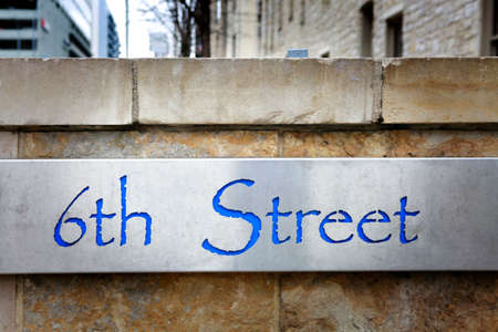 6th street sign. 6th street is famous life music street in Austin, Texas. Stock Photo