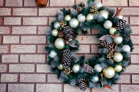 Christmas ornament on brick wall