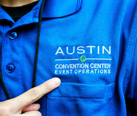 AUSTIN, TEXAS - MARCH 11, 2018: SXSW South by Southwest Annual music, film, and interactive conference and festival. Austin Convention Center, Event operation staff, sign on uniform.