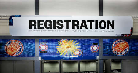 AUSTIN, TEXAS - MARCH 11, 2018: SXSW South by Southwest Annual music, film, and interactive conference and festival. Austin Convention Center, Registration sign and symbols. 新聞圖片