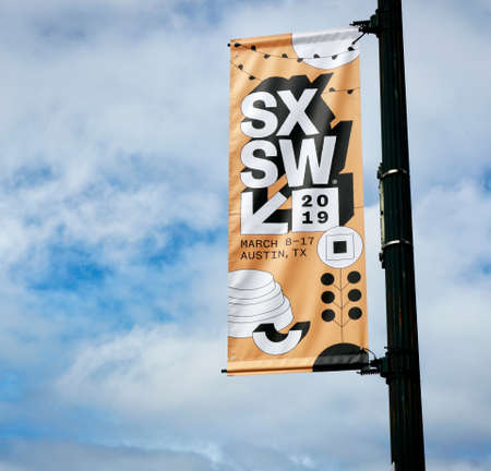 AUSTIN, TEXAS - MARCH 7, 2019: SXSW South by Southwest Annual music, film, and interactive conference and festival. SXSW posters in downtown Austin. Standard-Bild - 121148901