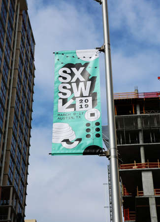 AUSTIN, TEXAS - MARCH 7, 2019: SXSW South by Southwest Annual music, film, and interactive conference and festival. SXSW posters in downtown Austin.