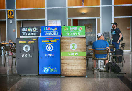 May 29, 2019. Austin–Bergstrom International Airport, Austin, Texas. Recycling bins: landfill, recycle, compost.
