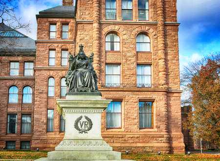 November 23, 2019, Toronto, Canada.  Queen Victoria statue seated on throne, at Queen's Park in Toronto, in front of the legislative assembly of Ontario. Editorial
