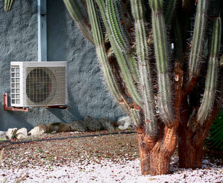 Split system air conditioner unit on stucco wall in hot tropical climate. Selected focus on air conditioner. Stock Photo - 143748003