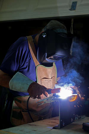 Welding. Welder is welding metal part