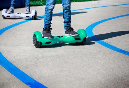 Kids having fun on Self-Balancing Hoverboard Scooter. 免版税图像 - 163539718