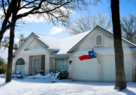 Austin, Texas.  Historic Arctic blast, winter storm.  House under snow.