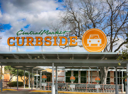 March 10, 2021, Austin, Texas.  CURBSIDE sign at Central Market. Central Market is an American gourmet grocery store chain owned by H-E-B Grocery Company.