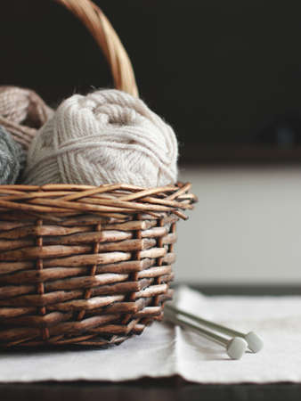 Wool in basket with needles Stock Photo