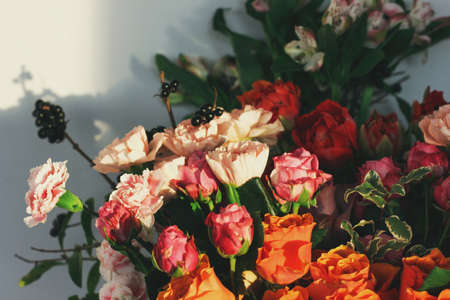 Different flowers in bouquet background