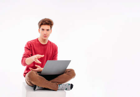 Teenager student working at laptop on white background