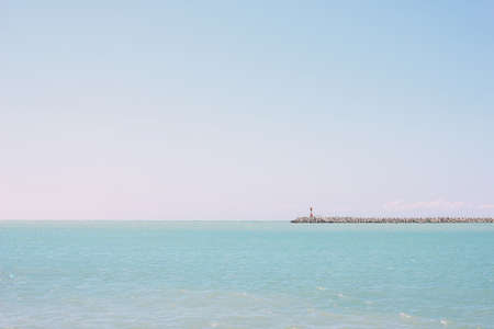 Minimal landscape of Black sea with lighthouse, Sochi, Russia, the nature background