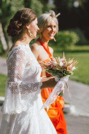 The happy bride and her best friend at the wedding party, bridesmaids Standard-Bild - 129478412