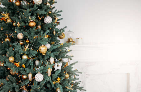 Decorated Christmas tree with gifts in bright living room, Scandinavian interior