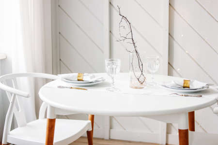 Festive table, minimalistic Christmas decor. Scandinavian interior