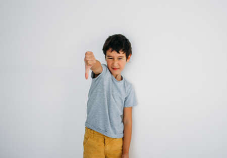 Frustrated Moody tween boy near wall at home