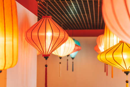 Colorful Chinese lanterns lamps on the ceiling textured background