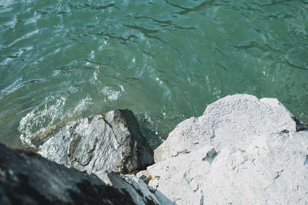 Close up photo of the turquoise mountain river, natural background