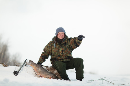 Russin Spearfishing with speargun shot a big fish under the ice of the river Volga near Volgograd area