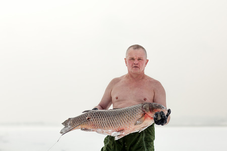 Underwater hunter shot fish on the water from a crossbow near Volgograd area