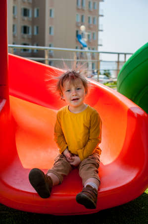The boy on the slide Static electricity